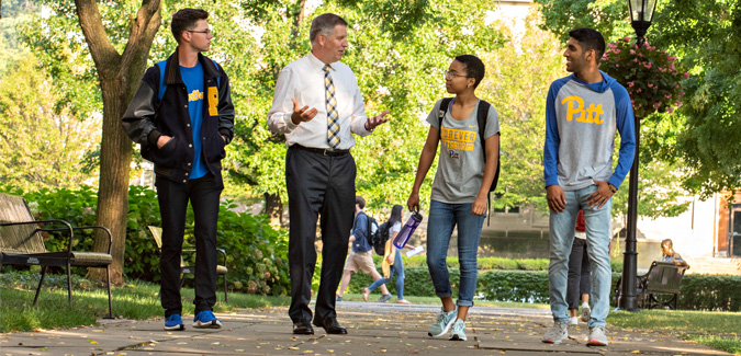 Chancellor Gallagher walking with students