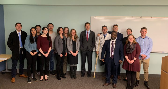 Group of students and researchers standing together with U.S. representative, Conor Lamb,  at the front of a classroom