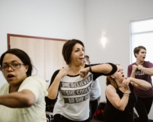 women participating in self-defense class