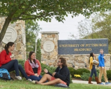 Students in front of the Pitt-Bradford sign