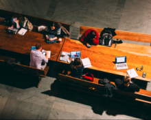 View of a group of students working at a table from above